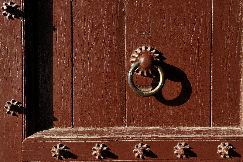 Interesting doors with metal handles. Fatehpur Sikri (Hindi: फतेहपुर सीकरी, Urdu: فتحپور سیکری) is a city and a municipal board in Agra district in the state of Uttar Pradesh, in North India. The historical city was constructed by Mughal Emperor Akbar beginning in 1570 and served as the empire's capital from 1571 until 1585. Though it took 15 years to build, it was abandoned after only 14 years of use because of shortage of water supply which was unable to sustain the growing population. The palace and mosque in Fatehpur Sikri are a tourist attraction and it is an UNESCO World Heritage Site which is about 40 km from the Taj Mahal, Agra. Uttar Pradesh state (UP), North India.