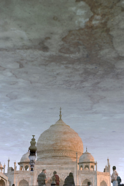 "Reflections of Taj Mahal.<br /> The garden uses raised pathways that divide each of the four quarters of the garden into 16 sunken parterres or flowerbeds. A raised marble water tank at the center of the garden, halfway between the tomb and gateway with a reflecting pool on a north-south axis, reflects the image of the mausoleum. The raised marble water tank is called al Hawd al-Kawthar, in reference to the ""Tank of Abundance"" promised to Muhammad. Due to its shape, the dome is often called an onion dome or amrud (guava dome). The marble dome that surmounts the tomb is the most spectacular feature."
