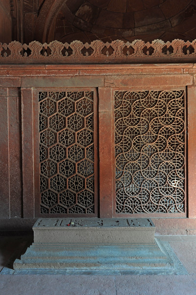 "Detailed ""jaali"" work done on stone near the tomb of sufi saint Salim Chisti.<br /> Fatehpur Sikri (Hindi: फतेहपुर सीकरी, Urdu: فتحپور سیکری) is a city and a municipal board in Agra district in the state of Uttar Pradesh, in North India. The historical city was constructed by Mughal Emperor Akbar beginning in 1570 and served as the empire's capital from 1571 until 1585. Though it took 15 years to build, it was abandoned after only 14 years of use because of shortage of water supply which was unable to sustain the growing population. The palace and mosque in Fatehpur Sikri are a tourist attraction and it is an UNESCO World Heritage Site which is about 40 km from the Taj Mahal, Agra. Uttar Pradesh state (UP), North India."