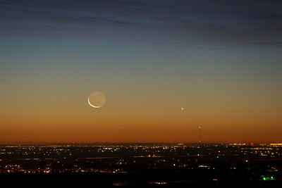 Moon and Venus rise over Colorado suburbs