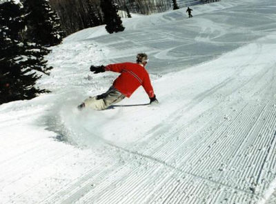 Marco Olm pro rider snowboard carving Snowmass, Colorado. Also on: http://bomberonline.com/
