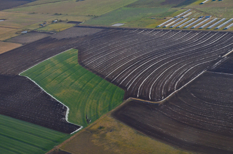 aerial shot of remaining snow on a farm after the farmer took advantage of a rare snow storm and tilled in the snow for more fertile lands in Central Texas January,2014©MegSeidel
