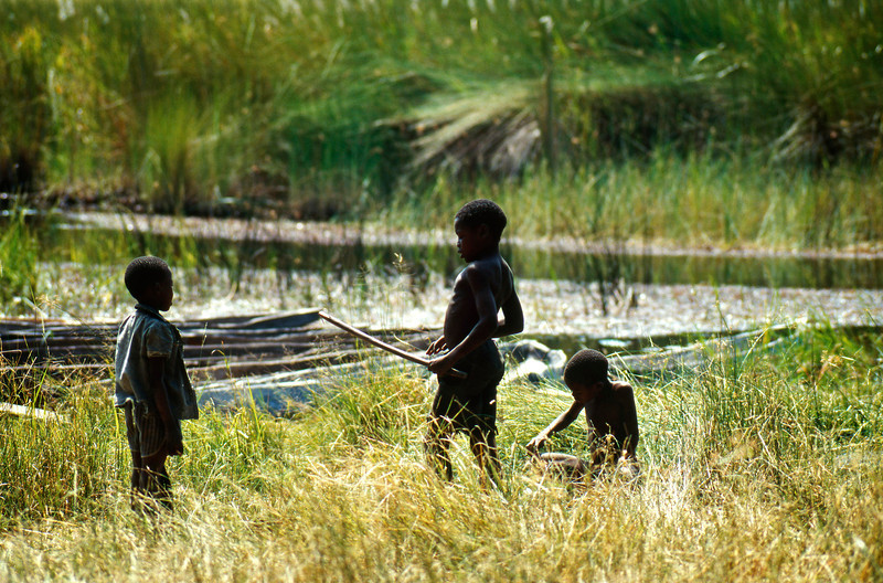 Boys playing in the Okavango Delta, Botswana (1994) © Copyrights Michel Botman Photography