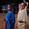 Kids playing hula hoop, Nyika Plateau, near Mzuzu, Malawi (1994) © Copyrights Michel Botman Photography