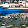 Cape Town waterfront, boat and reflections