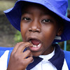 """Look, I have a new tooth"".  Sharon School, Harare, Zimbabwe (2011) © Copyrights Michel Botman Photography"
