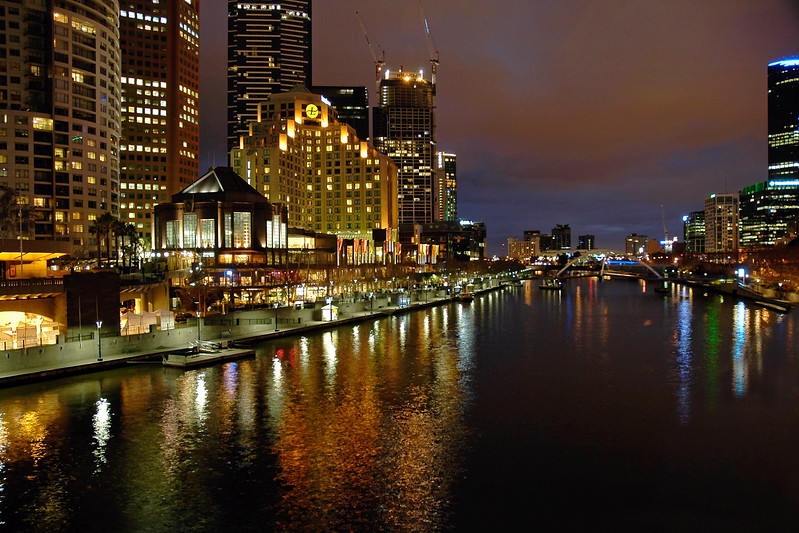 Night scene at Yarra River near Federation Square. Shot from Princess Bridge. Melbourne grew from the banks of the Yarra and even today the focus for the city is still very much on a one-kilometre section of the river. Within that one kilometre are some of the great sights and attractions of Melbourne. Seen here is the Southgate and Southbank Pomenade on the left with the Flinders Street Station on the right. Melbourne, Victoria (VIC), Australia.