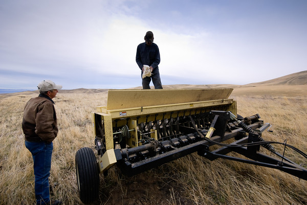 Loading the Seed Drill - Rattlesnake Ridge Restoration Project
