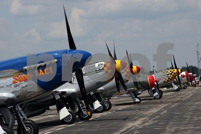 Row of WWII P-51 Mustangs on the tarmac(Thunder over Michigan 2005, Willow Run Airport in Ypsilanti, Michigan)