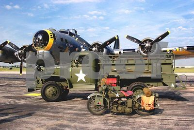 "WWII B-17 Flying Fortress bomber ""Liberty Belle"" with army truck and motorcycle (Thunder over Michigan 2005, Willow Run Airport in Ypsilanti, Michigan)"