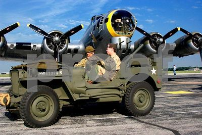 "WWII B-17 Flying Fortress bomber ""Liberty Belle"" with army jeep (Thunder over Michigan 2005, Willow Run Airport in Ypsilanti, Michigan)"