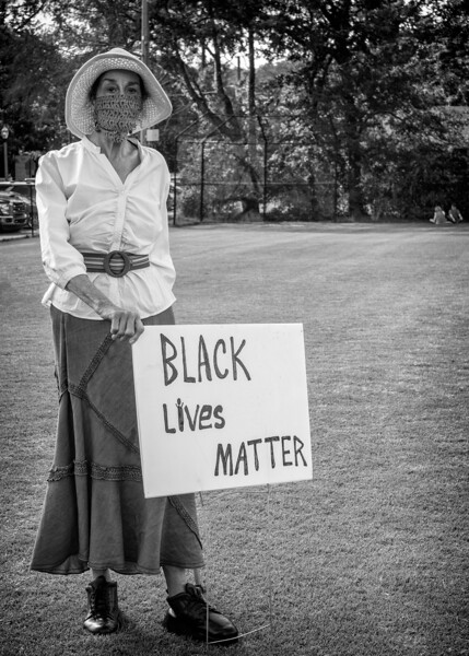 Lady with signage at Mountain brook rally for justice and BLM, June 4, 2020