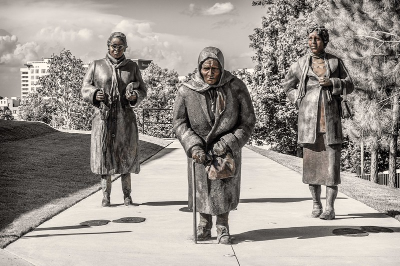 Sculpture of ladies walking during the bus boycotts of 1955-56 protesting racial segregation on public transit system; created by Dana King