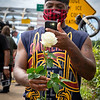 a man sharing a memorial rose via social media after the final crossing and jubilee for congressman and activist, john lewis, July 26, 2020