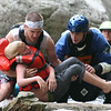 Rescuers carry a boy to safety after his family's self-guided whitewater raft failed to successfully navigate rapids of the Nantahala River in Wesser, N.C., on June 23, 2007.