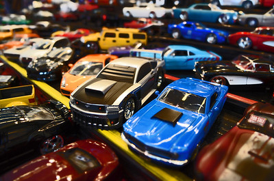 Model cars for sale at a car show.