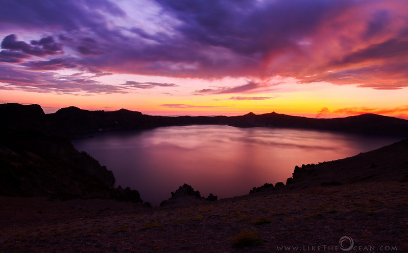 Bowl Of Fire - Twilight @ Crater Lake<br /> The Rim Drive – a 33 miles gorgeous and scenic highway circumventing the crater lake - make it an ideal place for enjoying both sun rise or sun set. There are tons of pull-outs to get off the road and see the lake. Be it the view points right on the road or the hikes out or the off road trails the views are equally amazing. <br /> <br /> This particular view is one of my favorite – so open and expansive - you can see the Phantom Island on the left , Wizard island towards center. The foreground with minimal vegetation and brittle soil, highlights the volcanic past. To add to all this, the sun decided to stage a grand drama that evening :) <br /> <br /> 'Bowl of Fire' – an attempt at capturing that moment, that grandeur to share with you !!!