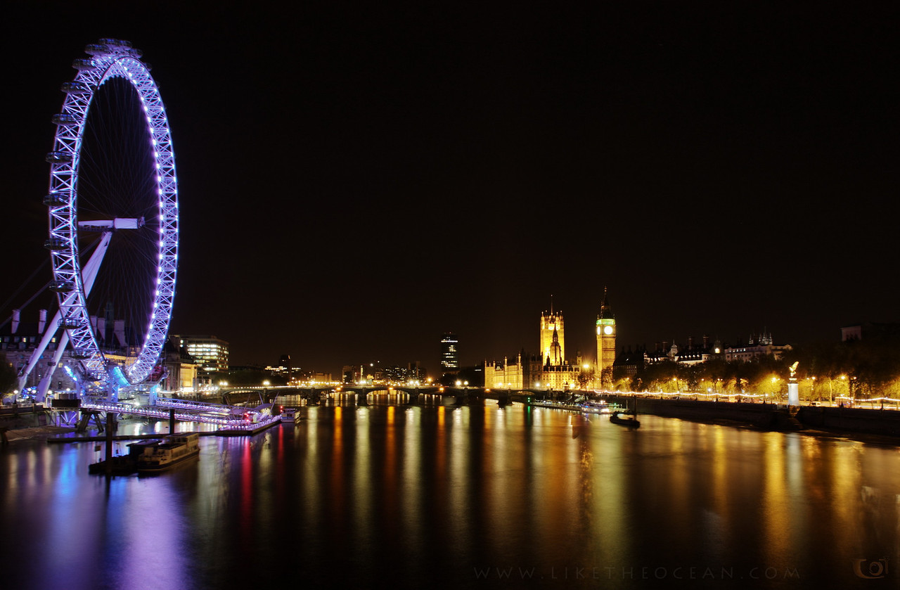 Getting all pumped for the London Olympics !   This week shot is from a quick stop over at London from the recent past. In this photo you can see the London Eye (left, obviously :) ) in its full glory and the Palace of Westminster + Clock Tower (right). This was shot from the Millennium Bridge as we were enjoy the a leisurely walk in the cool night's breeze. Though I was not there long enough to take a ride in the eye, the memories from the short visits to downtown is enough to pull me back there. May be sometime in future !  Taken with a Canon 7D + 18mm, 20.0s at f/8.0, ISO 100.