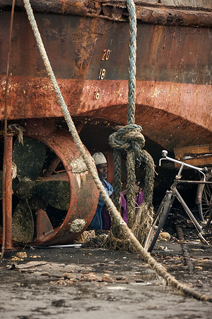 Hanging under the rusty boat