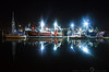 Reflections at the Dock<br /> This is from one of the docks at Newport, OR. Was real glad we took that turn to take a break, as we were heading back to Portland. The initial intent was to get a 5 mins break, but ended up spending a good hour and half walking / shooting at this dock. It was such a cold (in a good way) and calm evening. I have never in my life seen a dock that was so still. Pretty stroked at how sharp this turned-out right out of camera, especially with an exposure of 30 seconds !