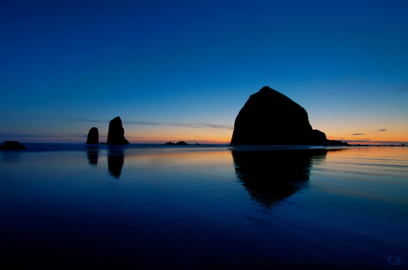 I love shooting at Cannon Beach.   It was fun getting this shot. I did not have any waterproof shoes that day and the water was biting cold. So it was more of cat & mouse play with the waves. I had envisioned to get the expanse of the beach and the receding water in the evening twilight. If you look real close you can see the light house too in the far horizon. To get this composition I set the tripod really close and low to the haystack rock. Shooting at 10mm helped capture the length of the beach and the Neutral Density Filter (ND3) helped increase the exposure to 20 seconds. Waiting for the sun to get below the horizon aided to capture the deep blue colors of Twilight.