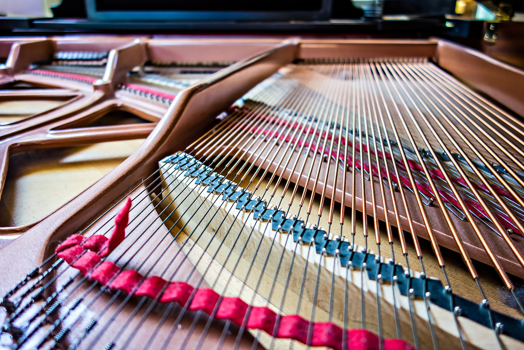 open piano strings and notes
