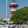 A clear blue sky features the Harbour Town Lighthouse - famous landmark in Hilton Head, SC, USA