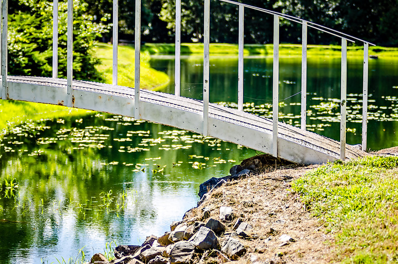 white steel bridge over gasden pond