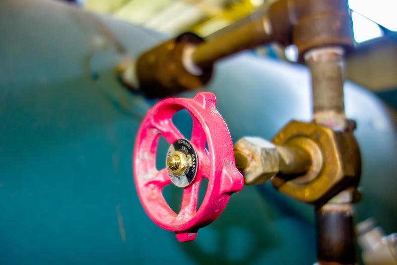 various old boiler room pipe valves