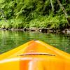 view from kayak towards mountain river rushing waters