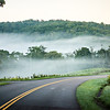fog rolling through blue ridge parkway farm lands