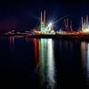 fishing boats in marina at night