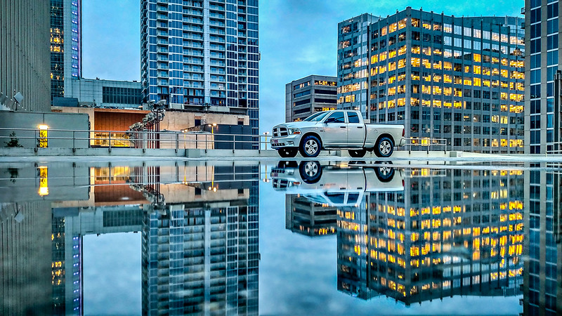 truck reflection in the puddle after rain