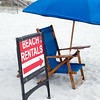beach umbrella and chair rentals sign