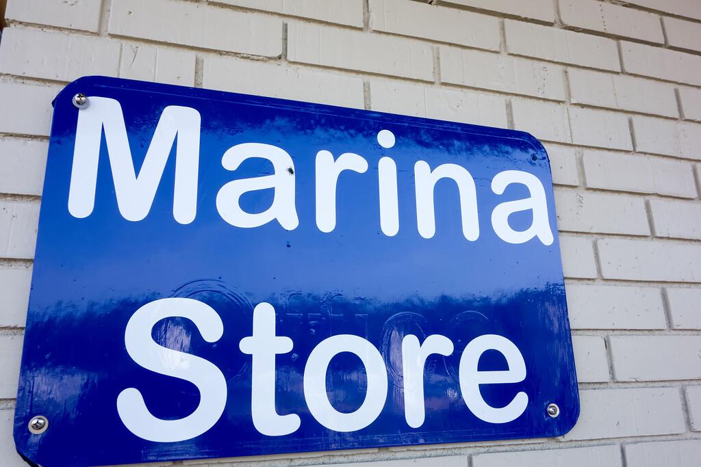boat marina store sign on brick masonry wall