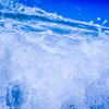 blue crystal water waves crashing on beach