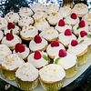 full plate of cup cakes on party table