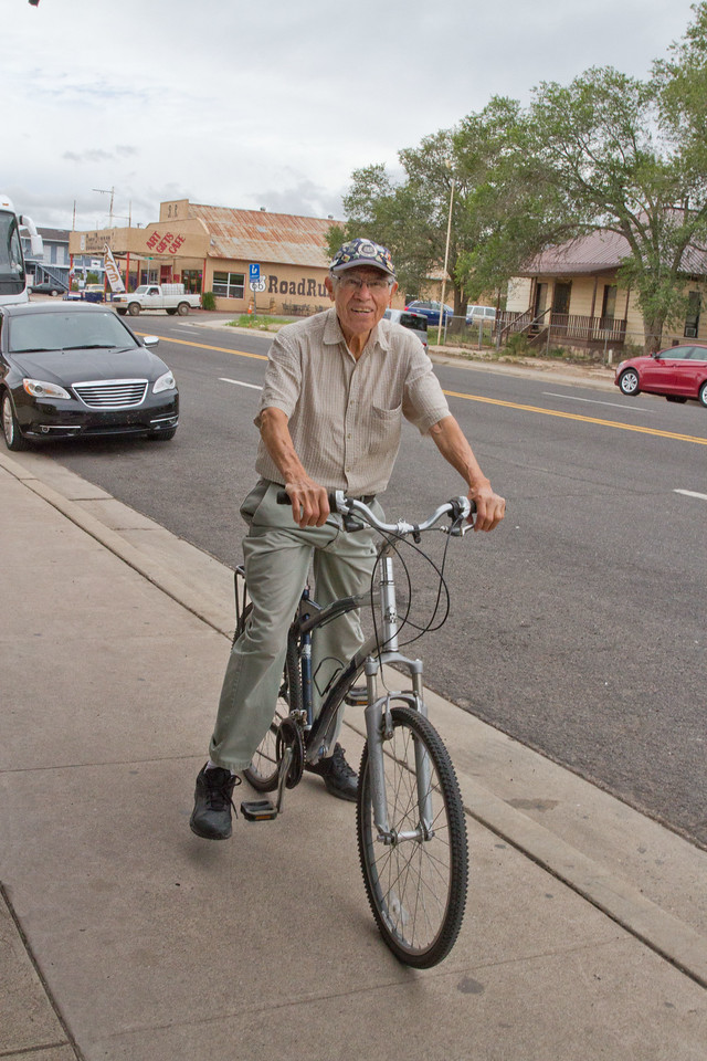 Angel Delgadillo, 86, Known internationally as 'The Guardian Angel of Route 66,' bikes over to his barber shop / souvenir store after a mid-day nap to greet guests and sign a few autographs.  In 1987, just two years after Interstate 40 bypassed Seligman, Angel founded the Arizona Historic Route 66 Association.   Soon to follow, the remaining seven Route 66 States established similar organizations - all dedicated to rebuilding, preserving and continuing the legacy that is the Mother Road.