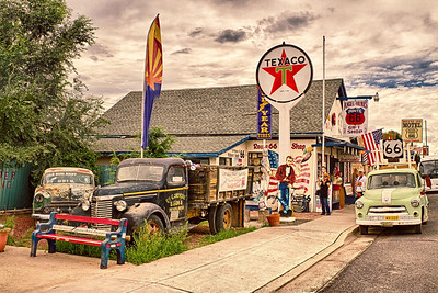 Angel & Vilma's - Rt 66, Seligman, Arizona.  Known internationally as 'The Guardian Angel of Route 66,' every day, Angel Delgadillo, 86, bikes over to his barber shop / souvenir store after a mid-day nap to greet guests and sign a few autographs.  In 1987, just two years after Interstate 40 bypassed Seligman, Angel founded the Arizona Historic Route 66 Association.   Soon to follow, the remaining seven Route 66 States established similar organizations - all dedicated to rebuilding, preserving and continuing the legacy that is the Mother Road.