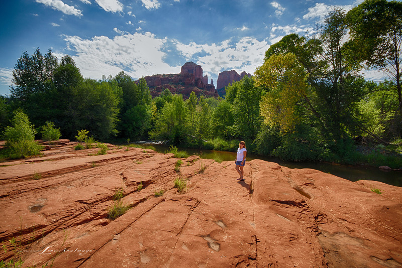 Red at the edge of Oak Creek with Cathedral Rock behind - Red Rock State Park, at the flats, Sedona, Arizona