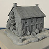 Stone Farmhouse - Prototype/Master<br /> My goal here was to emphasize the aged elements.  Sagging roof lines and shutters, a cracked stoop as well as an open window and doorway were incorporated into this sculpt.  (some damage due to molding process)