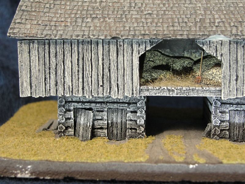 Detail: Aged wood and interior with pitch fork and hay.