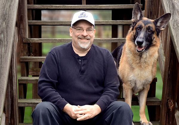 <b><i>I tried to find a photo of me in college to accompany this entry, but there just weren't any that were suitable.<br><br>  So here is a current photo of me along with my assistant, Blitz. He accompanies me on many photo adventures providing companionship, security and advice.</i></b>