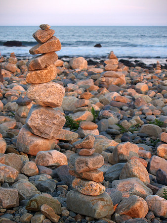 Cairns on rocky beach at Point Judith Light, RI