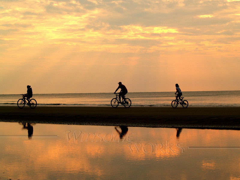 Biking at sunrise; Hunting Island SP, SC