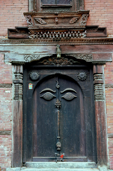 Old Carved Doorway with Buddha's Eyes, Hanuman Royal Palace - Nasal Chowk, Durbar Square - Kapmandu, Nepal