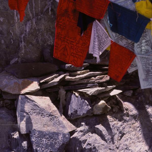 Prayer flags and stone carvings behind Potala Palace  -- Lhasa, Tibet