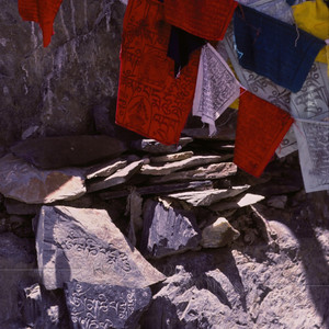 Prayer flags and stone carvings behind Potala Palace  -- Lhasa, Tibet