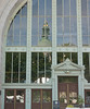 United States Navel Academy Dahlgren Hall with reflection of Chapel dome in the window