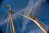 Crew member climbing the mast of the Pride of Baltimore